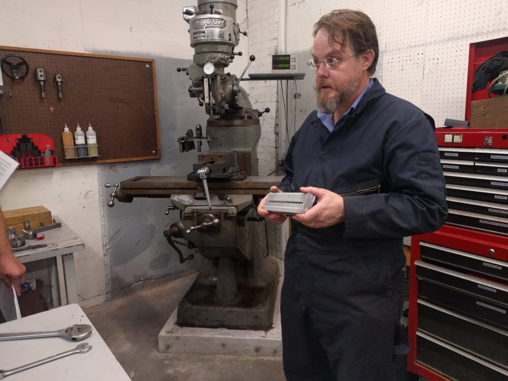 Christopher Perry demonstrates the Bridgeport Milling Machine